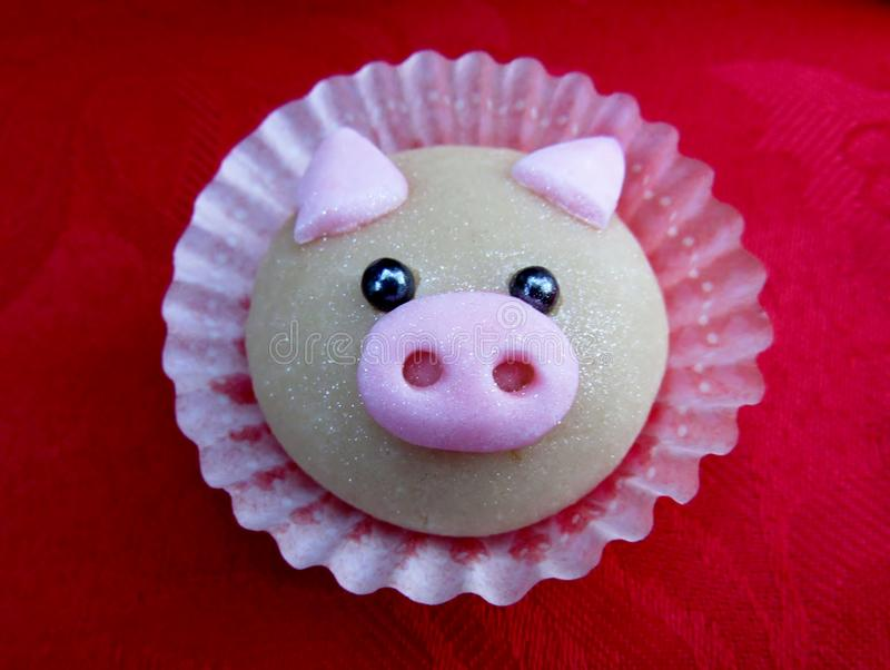 Cute pig cookie. Cute pig cookie on red napkin royalty free stock photos