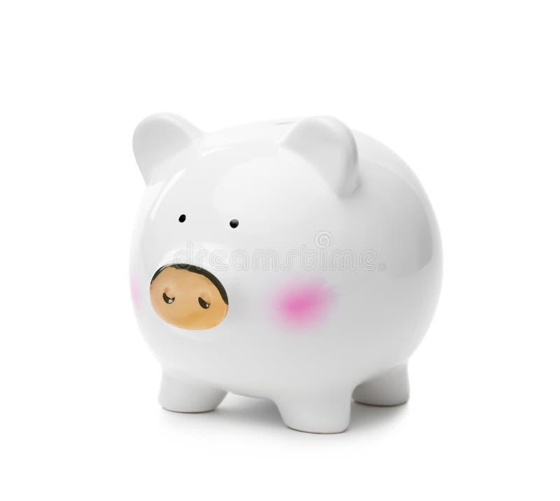 Cute piggy bank with golden snout stock photos