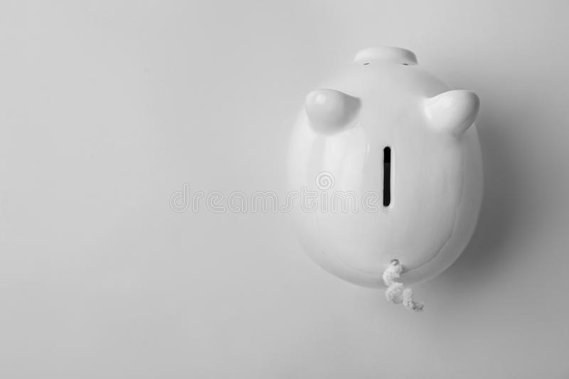 Cute piggy bank on white background, top view stock image