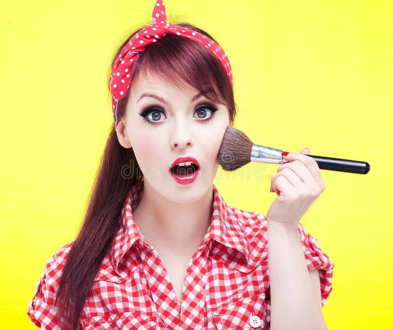 Cute Pin Up Girl Applying Blusher Stock Image