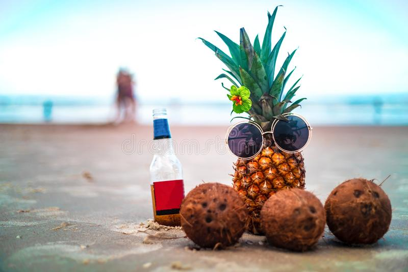 Cute Pineapple Hibiscus Flower with Coconuts On Sunny Beach. Cute Pineapple and Coconuts On Sunny Beach stock image