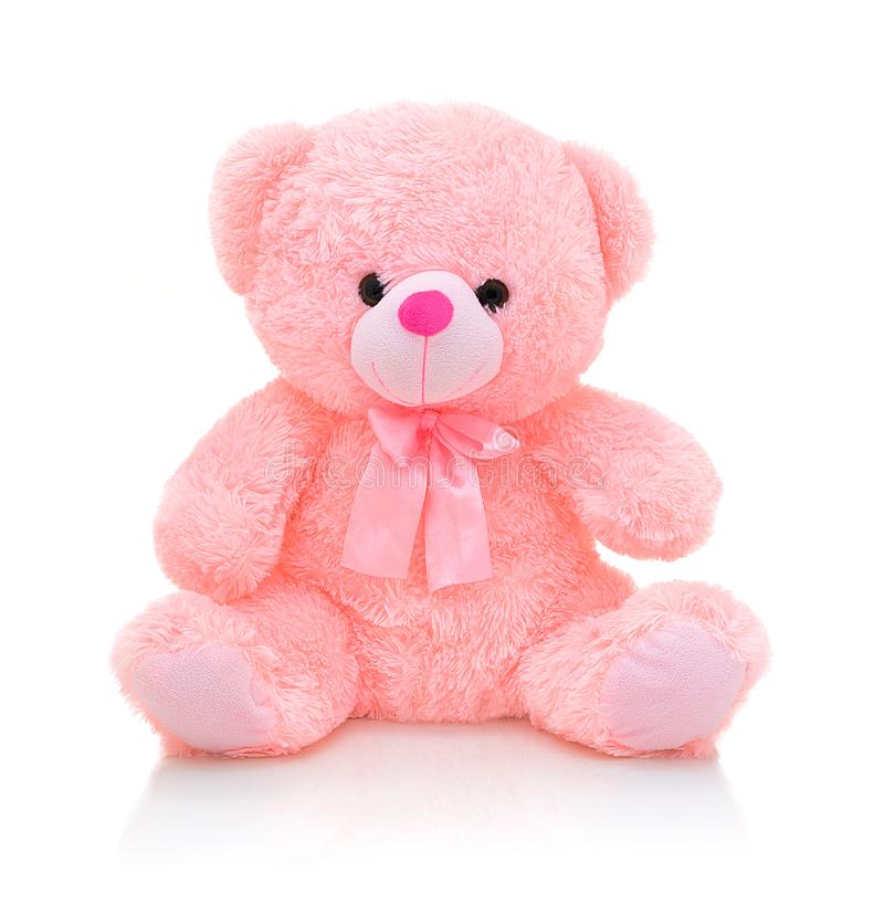 Cute pink bear doll with bow on white background with shadow reflection. Playful bright pink bear. stock image