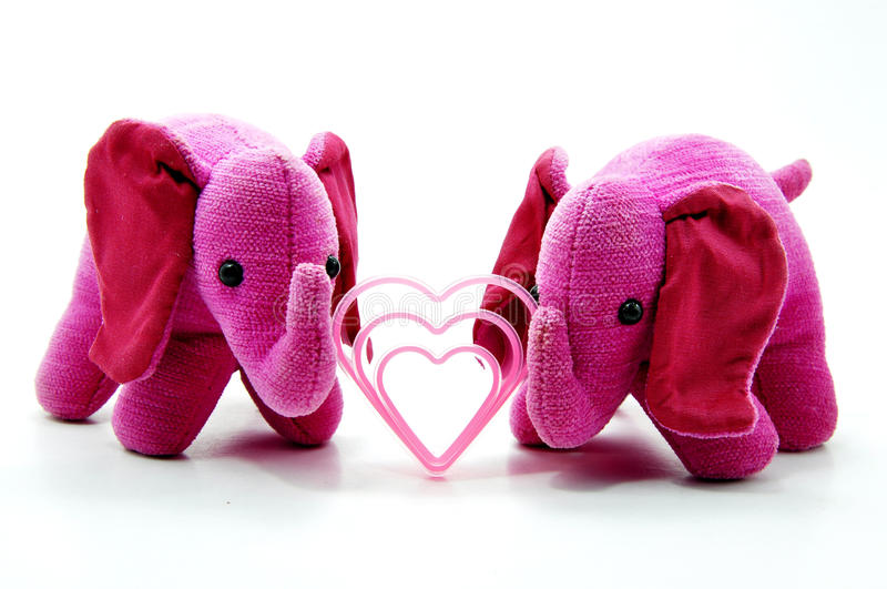 Cute pink elephant toys royalty free stock photography