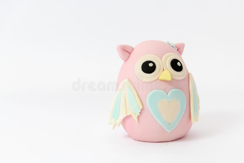 Cute pink owl cartoon character. Isolated on a white background stock images