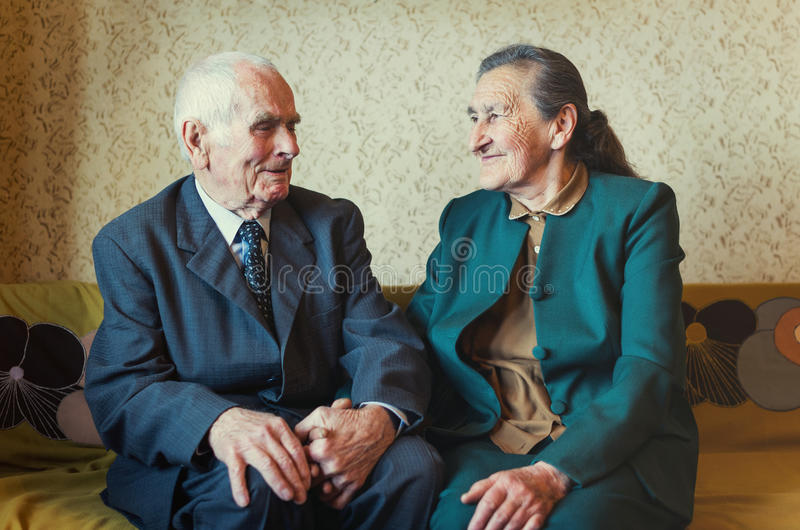 Cute 80 plus year old married couple posing for a portrait in their house. Love forever concept royalty free stock photos
