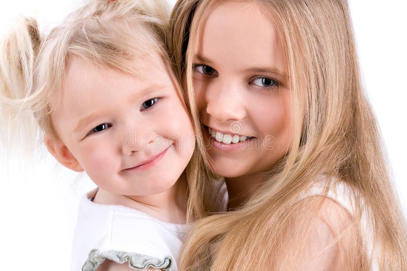 Cute Portrait Of Two Sisters Royalty Free Stock Images