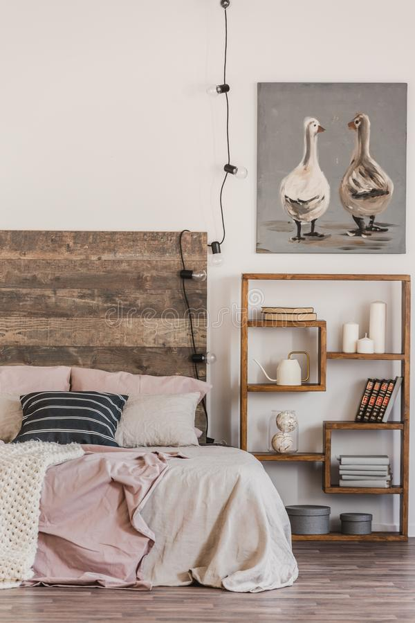 Free Cute Poster With Two Ducks On White Wall Of Tasteful Bedroom Interior With Bed With Pastel Pink Bedding Royalty Free Stock Photography - 150214987