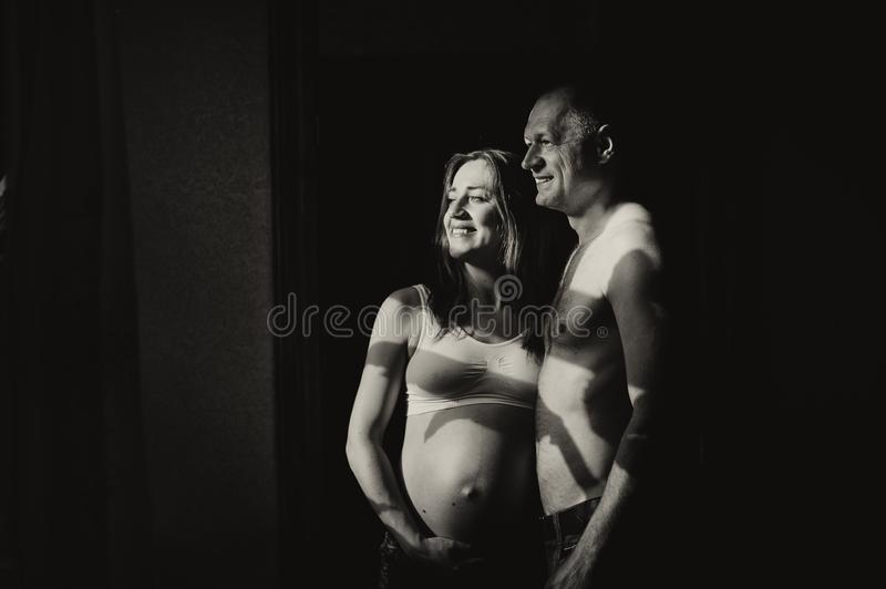 Cute pregnant woman touching her belly royalty free stock image