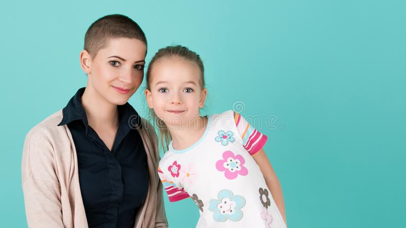 Cute preschool age girl with her mother, young cancer patient in remission. Cancer patient and family support. Cute preschool age girl with her mother, young royalty free stock photo