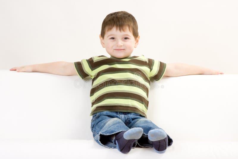 Cute preschool boy on sofa royalty free stock image