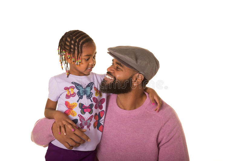 Cute preschooler and dad. Preschooler and her dad isolated on white stock photography