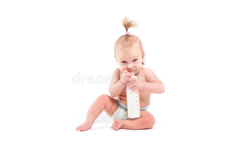 Cute pretty baby girl in white diaper hold bottle stock photos