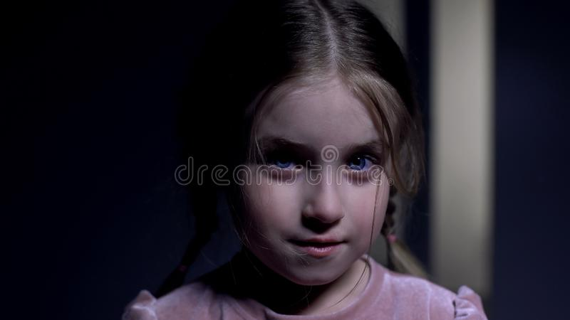 Cute pretty girl with blue eyes looking at camera and smiling, orphan profile royalty free stock image