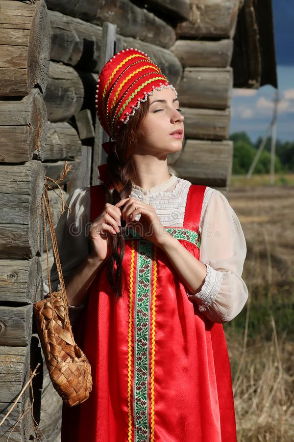 Girl in traditional dress wooden wall royalty free stock images