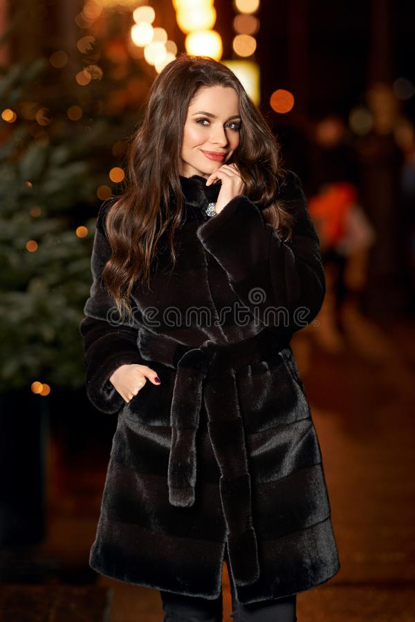 Young pretty woman in fur coat stock images
