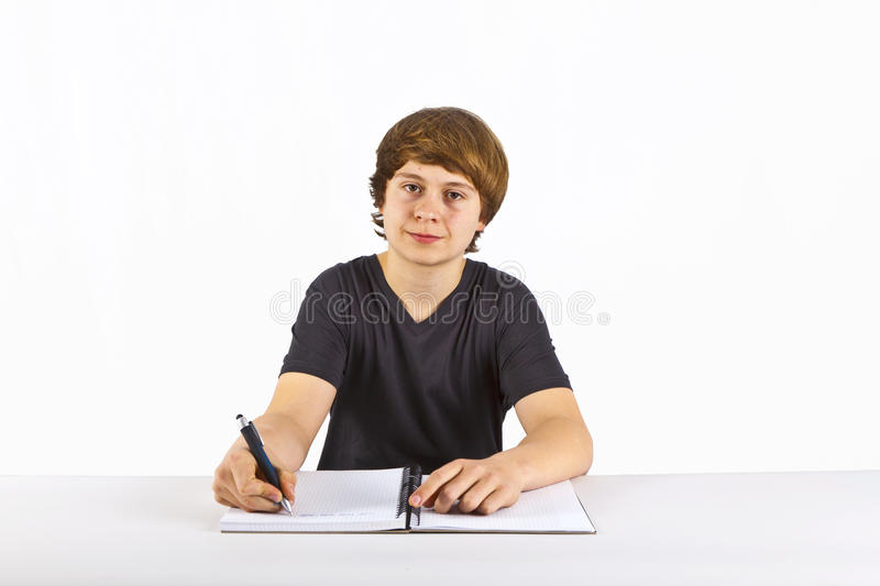Cute pupil doing homework for school royalty free stock photography