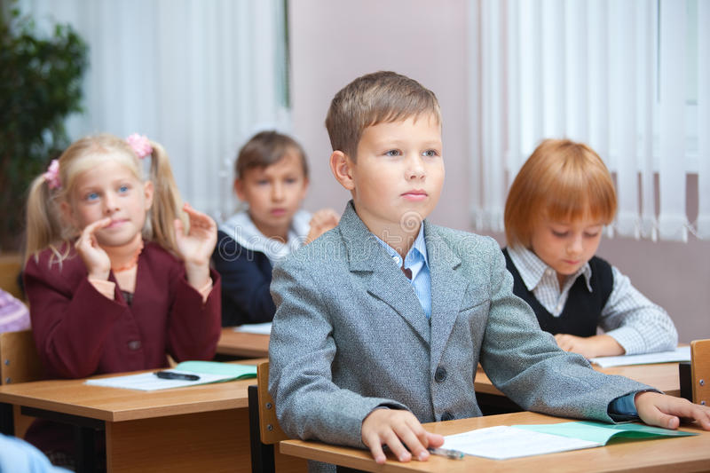 Cute Pupils On Real Lesson Stock Photos