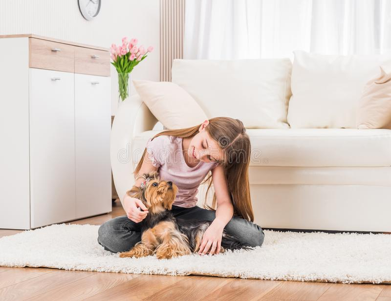 Cute puppy and happy young girl royalty free stock photos