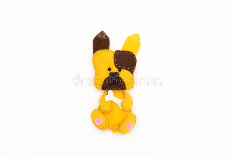 Little toy dog on white background stock photography
