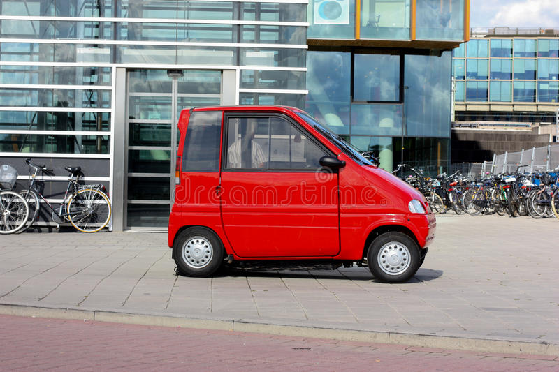 Cute red car. In Amsterdam, Netherlands stock photos