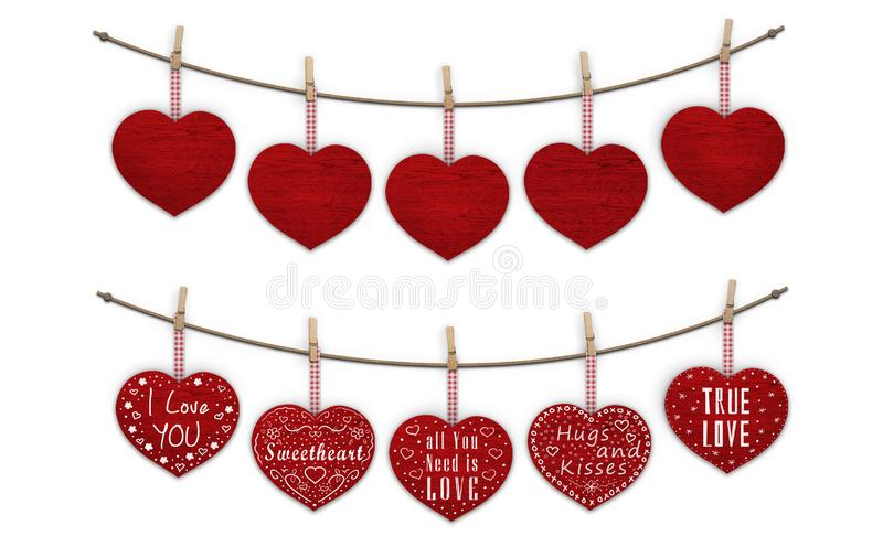 Cute red wooden hearts hanging on clothes pegs, blank and decorated with text I love you royalty free stock images