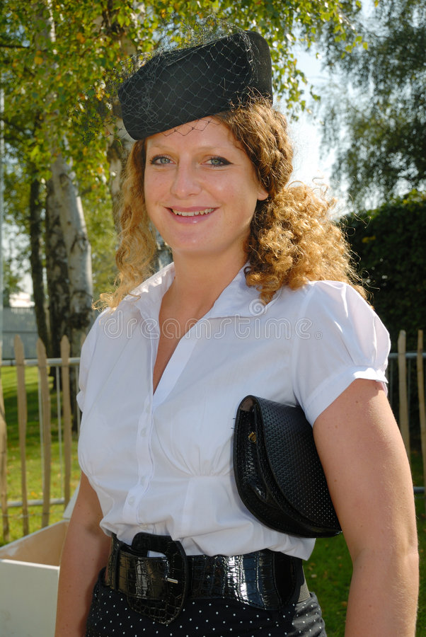 Cute redhead in fifties pillbox hat royalty free stock photo