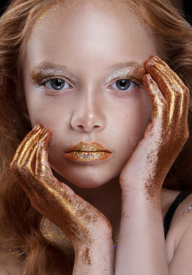 Free Cute Redhead Teenage Model With Bright Makeup And Colorful Glitter And Sparkles On Her Face And Body. Royalty Free Stock Photography - 104601107