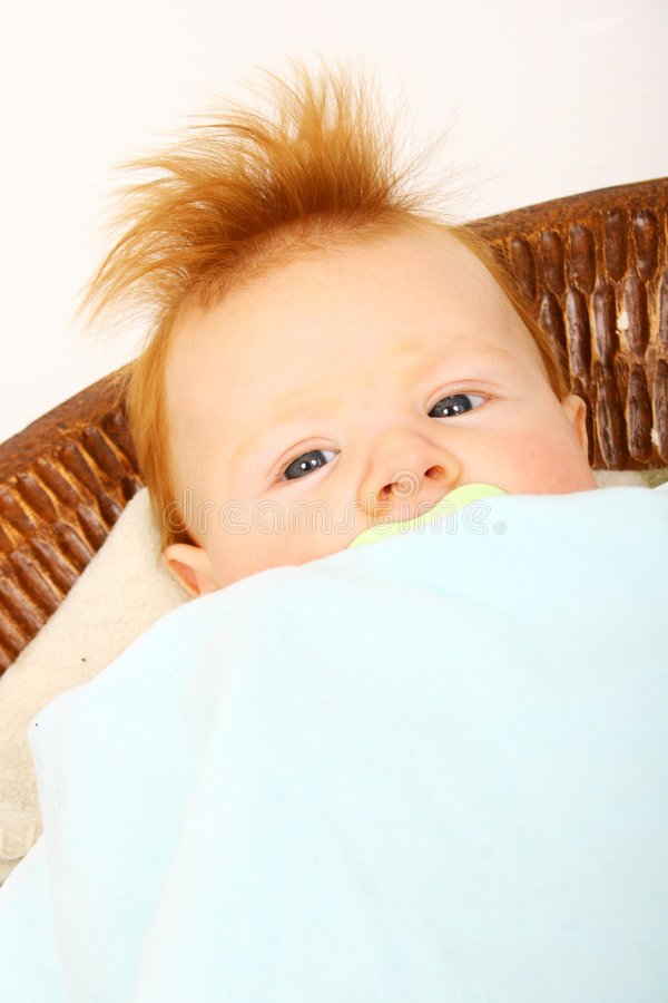 Cute Redheaded Baby. Adorable little baby with fuzzy red hair stock image