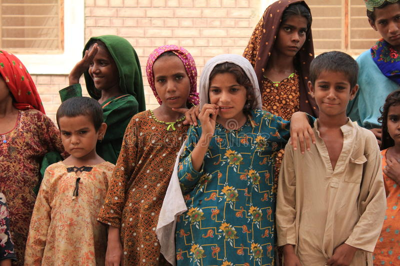 Cute Refugee Children in Pakistan. A Group of Cute Refugee Children pose for the camera at a refugee camp in Shikarpur, Pakistan. These children are amongst royalty free stock photos