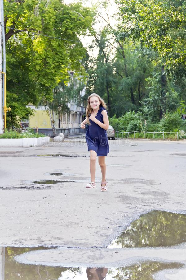Caucasian girl run in summer with disheveled hair. Cute running European girl with disheveled hair in green park stock images