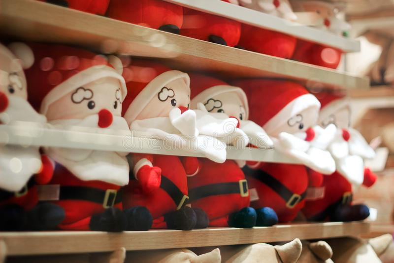 Cute Santa Claus doll group in the room background. The Cute Santa Claus doll group in the room background. Merry Christmas and Happy New Years royalty free stock photo