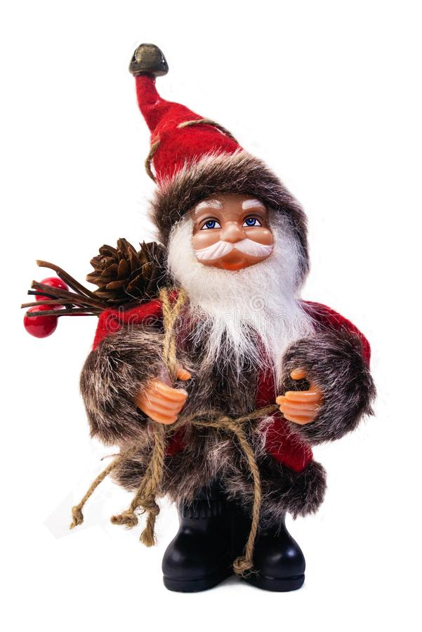 Cute Santa Claus doll. Cute isolated Santa Claus toy with bag of presents. Santa doll photo royalty free stock images