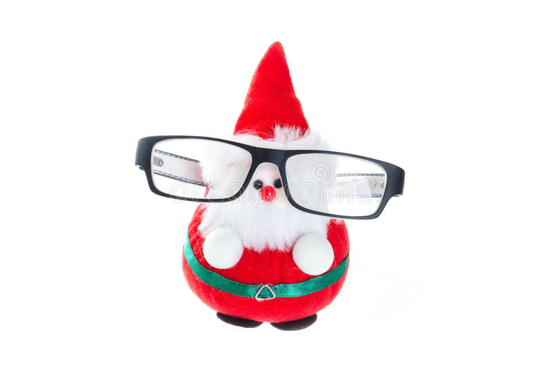 Cute santa doll with eye glasses. Cute red hat santa doll with eye glasses isolated on white stock photos