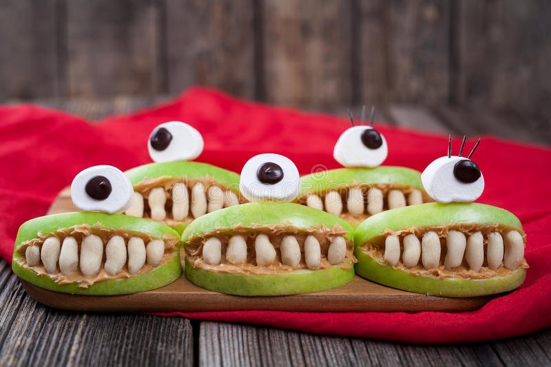 Cute scary halloween apple cyclop monsters food royalty free stock photography