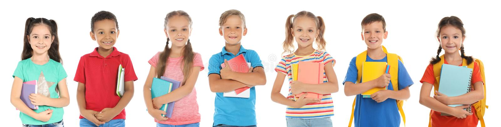 Cute school children with stationery royalty free stock photography