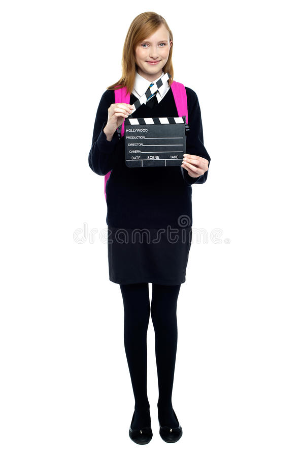 Cute School Girl With A Clapperboard Royalty Free Stock Photography