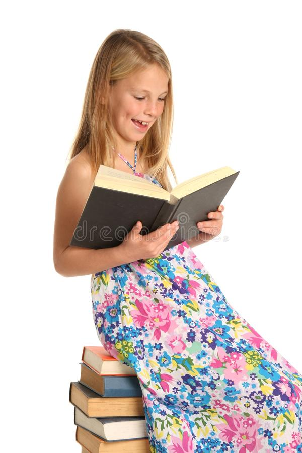 Cute School Girl Sitting on Books royalty free stock images
