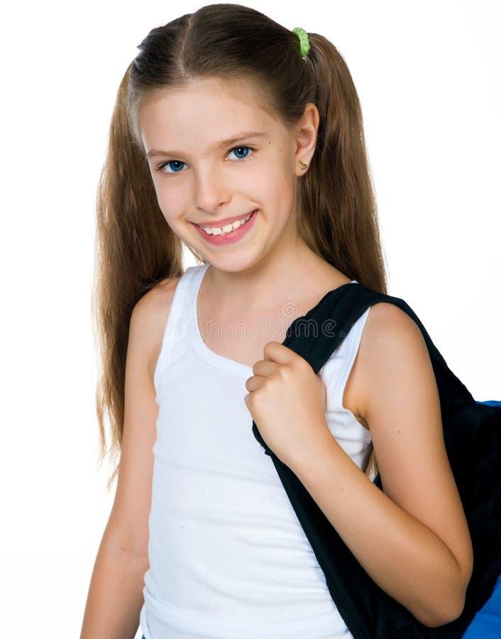 Cute schoolchild with knapsack. On white background royalty free stock image