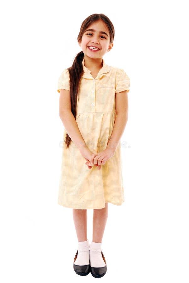 Cute schoolgirl. Smiling schoolgirl in summer uniform isolated on white royalty free stock image