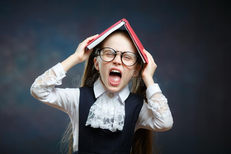 Cute Schoolgirl Shout Cover Head with Open Book stock photography