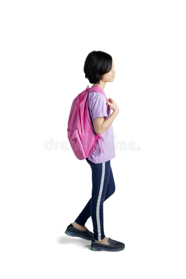 Cute schoolgirl stepping in the studio royalty free stock photography