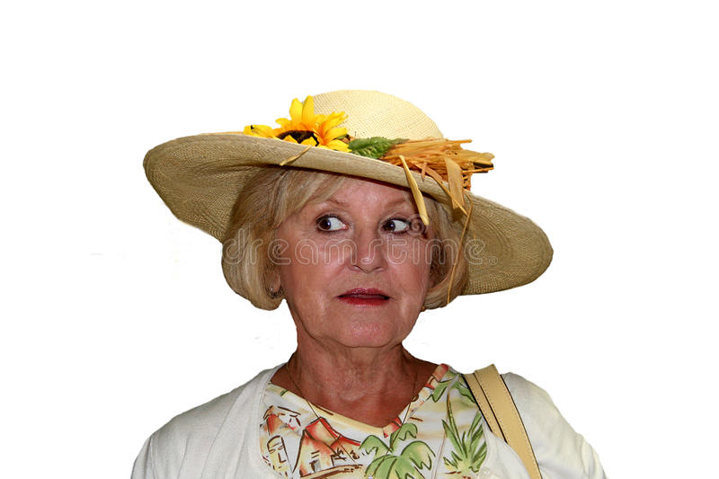 Cute Senior Woman. Senior woman with silly expression in a straw hat royalty free stock image