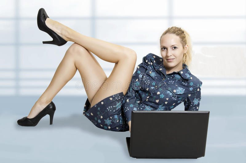 Cute woman with laptop computer stock image