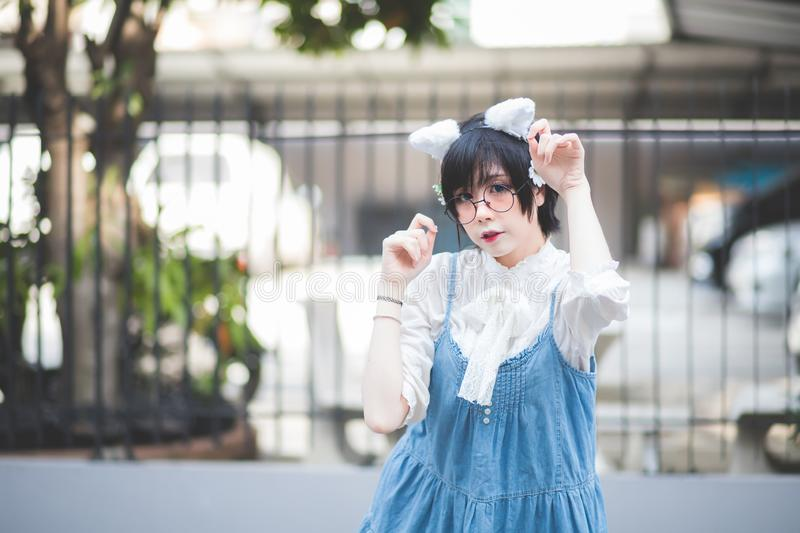 Cute short haired Asian women, Thai people, dressed in Japanese cosplay costumes in a concept outdoor during the daytime. royalty free stock images