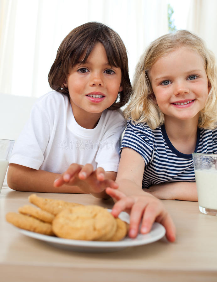 Download Cute Siblings Eating Biscuits Stock Photo - Image: 12617628