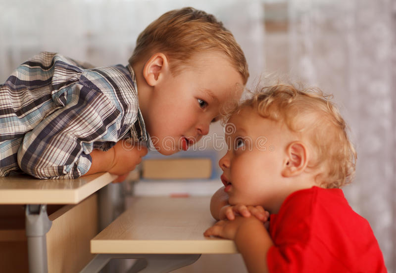 Cute siblings. Two little brothers. stock photos