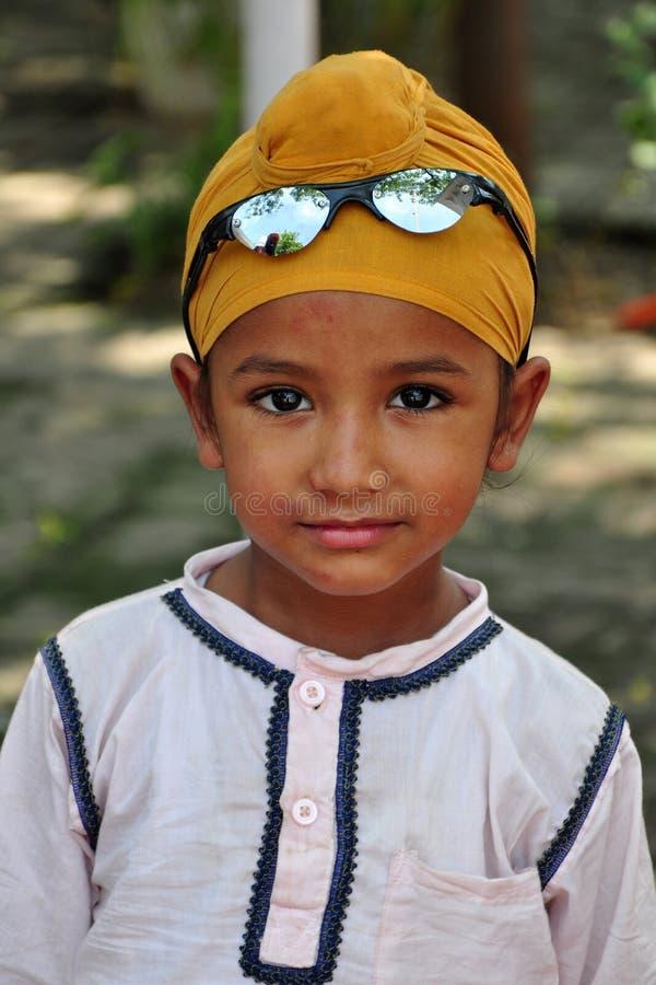 Cute sikh boy. Portrait shot of cute indian sikh boy royalty free stock photos