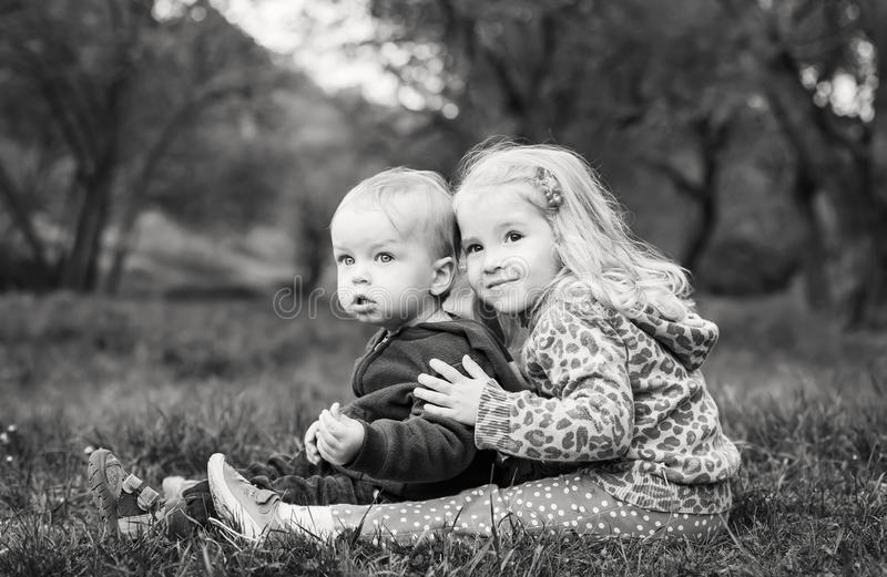 Download Cute Sister Hugging Brother Stock Image