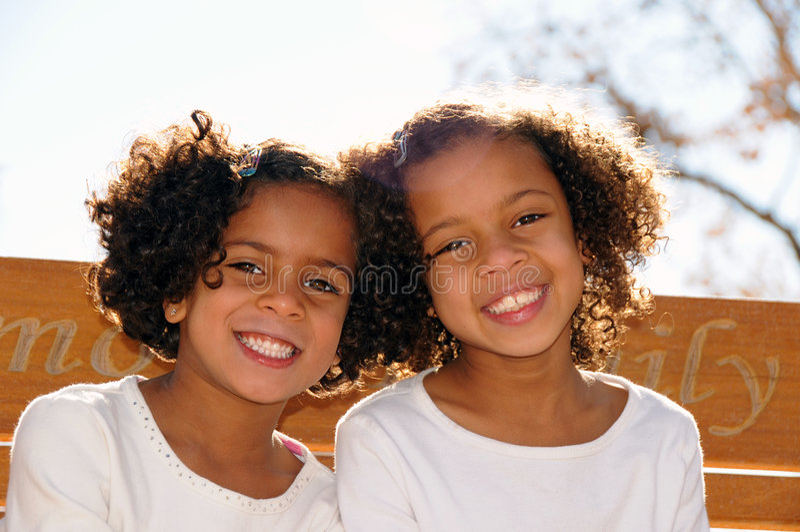 Cute Sisters stock photo