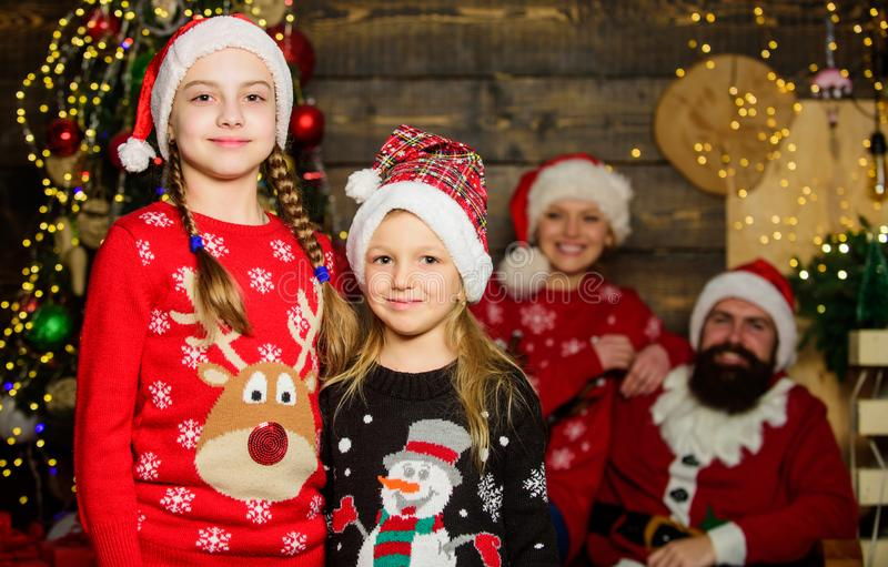 Cute sisters and parents celebrate christmas at home. Family spread love and happiness. Adorable family enjoy christmas stock photo